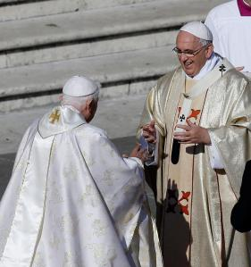 Pope Francis greets Pope Emeritus Benedict XVI. In a surprise move Pope Francis has declared a Holy Year of Mercy beginning December 08th 2015 (Feast of the Immaculate Conception)